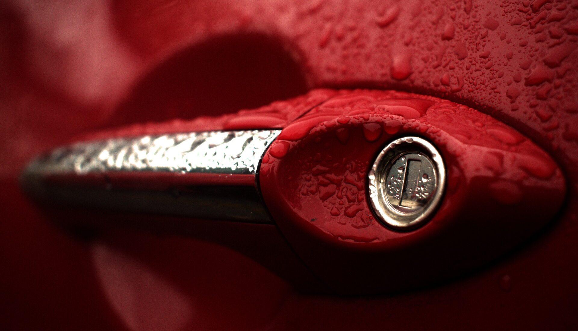 Singing in the Pain, rainy red car door handle